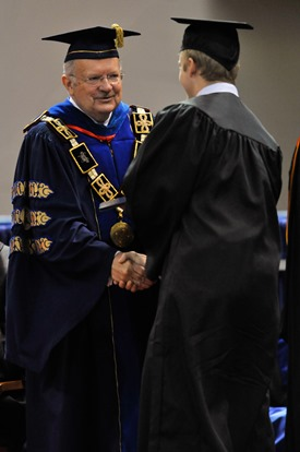 Louisiana Tech President Dan Reneau awards a diploma during his final commencement ceremony