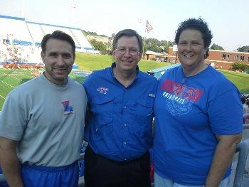 Rhonda Boyd (right) is joined by Louisiana Tech President Les Guice (center) and Kinesiology Professor David Szymanski