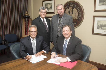 From left - Riverside Research President Richard Annas, Louisiana Tech VP for R&D Stan Napper, Riverside Chief Scientist John Morris, Louisiana Tech President Les Guice