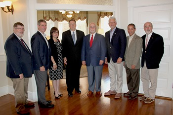 From left: Dr. Mark D. Gibson, Roy O. Martin, III, Carole Martin Baxter , Dr. Les Guice, Jonathan Martin, Scott Poole, Mikey Rachal and Dr. James D. Liberatos took time to pose for a picture together during reception at the Ropp Center.