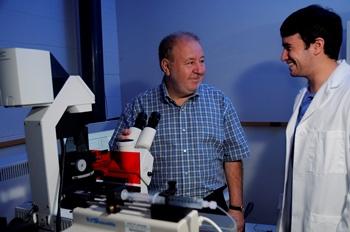 Dr. Yuri Lvov (left) works with a student at Louisiana Tech University.