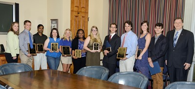 Louisiana Tech President Les Guice (far right) Dr. Melinda Bryan (far left) and the 2014 Undergraduate and Graduate Research Symposium winners.