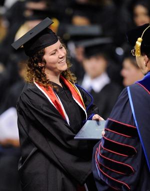 SGA President Allison East receives her diploma from President Les Guice
