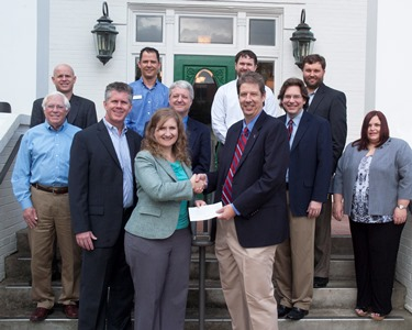 Jennifer A. Johnson (front left) and Dr. Hisham Hegab (front right) are joined by faculty from the College of Engineering and Science and representatives from ExxonMobil for the check presentation.