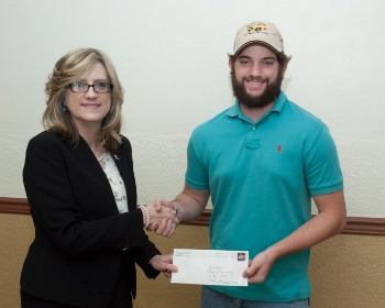 Dr. Jenna Carpenter (left) presents Patrick Michael Reilly with a scholarship award from the Scottish Rite Foundation.