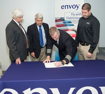 Representatives from Louisiana Tech and Envoy Air sign agreement for pilot training program.