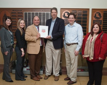 Dr. Hisham Hegab (third from right) receives gift from Phillips 66.