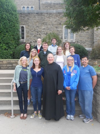 Louisiana Tech honors students visit with Brother Francis of Subiaco Abbey.
