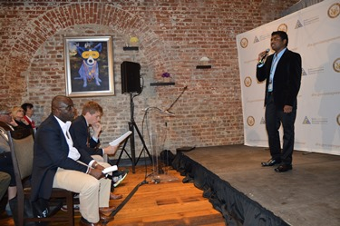 Kopparthy (right) presents his innovation to guests, investors during NOEW.