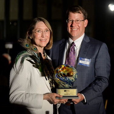 Dr. Susan Roach receives the Louisiana Endowment for the Humanities Award for Lifetime Contribution to the Humanities from Drew Tessier of LEH Board of Directors (Photo credit: Louisiana Endowment for the Humanities.)