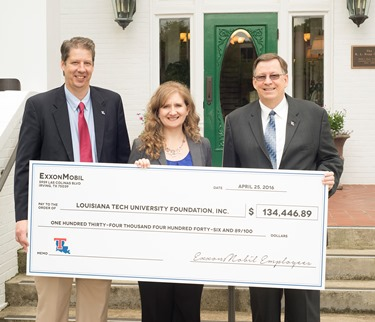 ExxonMobil's Jennifer Johnson (center) presents check to Louisiana Tech President Les Guice (right) and COES Dean Hisham Hegab.