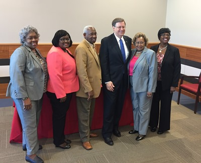 Louisiana Tech President Les Guice (third from right) with Bertha Bradford-Robinson (second from right) and family.