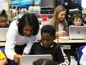 Angela Byrd, foreground, and Kerrigan Pettis, background, help third grade students learn to use an online math program at Sallie Humble Elementary in Monroe on Tuesday, Nov. 15, 2016. Byrd, who is in her 30th year of teaching, is Pettis' mentor. Pettis, a senior at Louisiana Tech, is one of three clinical teaching residents at Sallie Humble, spending the entire year co-teaching with Byrd, rather than only spending 12 weeks in a traditional student teacher program. - Photo Courtesy of News-Star.
