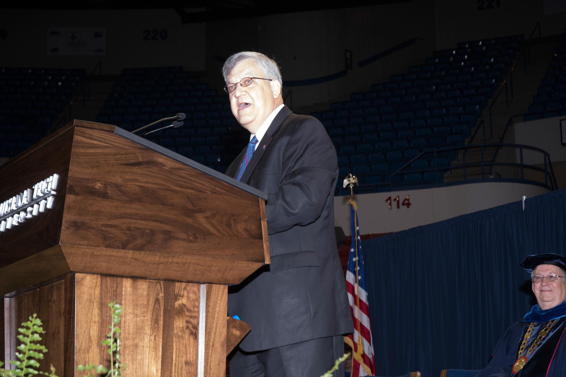 Dr. Stan Napper speaks at graduation.