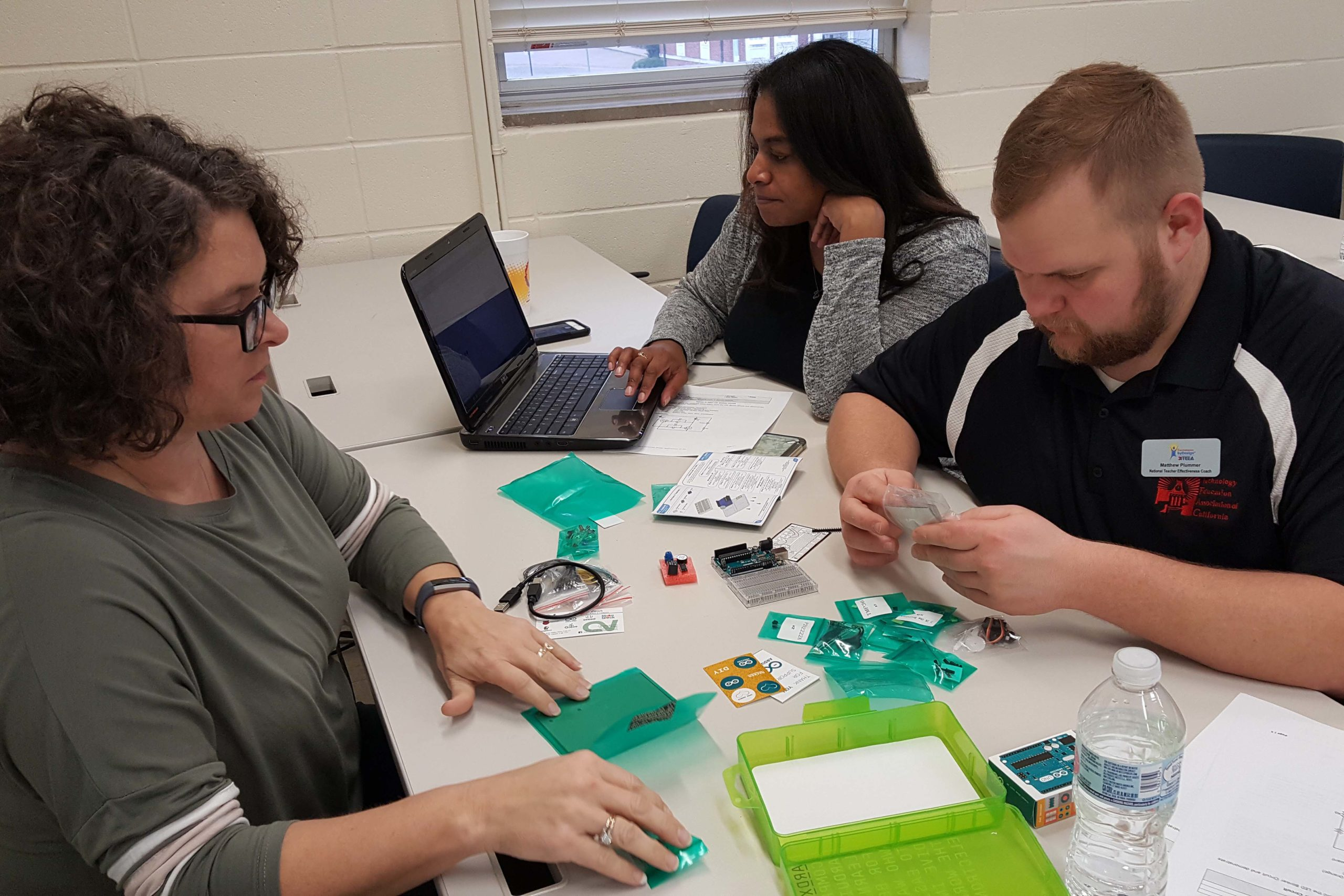Missy Wooley, Educational Consultant for the Louisiana Department of Education, works with colleagues from across the nation using arduinos during the three-day national ITEEA training at Louisiana Tech's SciTEC in the College of Education.