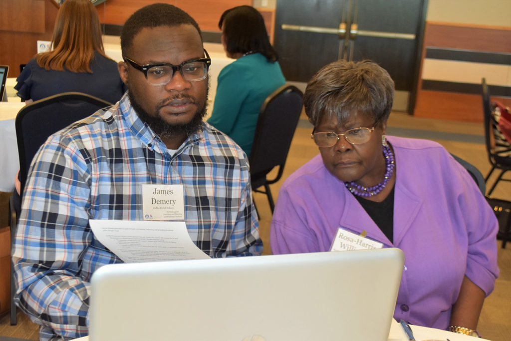 Teachers engage with technology to benefit their classes during a College of Education workshop.
