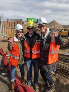 Katya Opel (left) and Chloe Wallace (right) with Louisiana Tech graduate and Kiewit employee Mallory Walters.