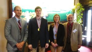 Pictured are members of the winning team with Dr. Henry Cardenas.