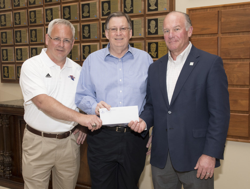 University of Louisiana System President and CEO Dr. Jim Henderson and Louisiana Tech President Dr. Les Guice accept funds from Louisiana Tech University Foundation Board President Bill Hogan. Donations toward the University Excellence Fund are being used to assist faculty and staff members who suffered catastrophic losses during the April 25 tornado.