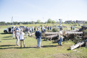 Students move debris during the Big Event.