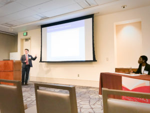 "Sam Dinnat presents his original research titled ""What portion of the volatility of the interest rate can be attributed to excess reserve policy? Does including this relationship as an exogenous variable make other macroeconomic forecasts better?"" at the Economic Scholars Program (ESP) at the Federal Reserve Bank of Dallas."