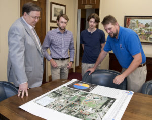 Dr. Les Guice, Conner Killian, Bradley Brown and Dr. Josh Adams discuss the mapping of damaged trees after the April 25 tornado.