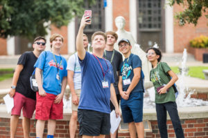 Students take a selfie by the Lady of the Mist.
