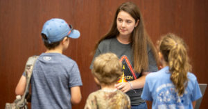 Tech student explains her work at NASA during the RockOn camp.