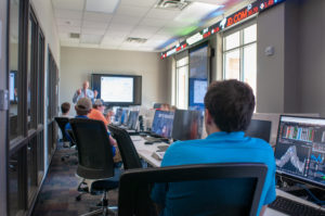Students engage in world-class education through applied and experiential learning in Ray's Trading Room.