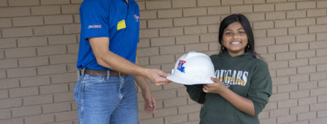 AGC President Jeb Kraft giving the hardhat award to Maryan Wasiuddin