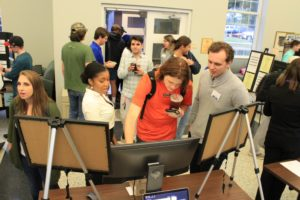 Students interact with product teams at the TOP DOG pitch competition.