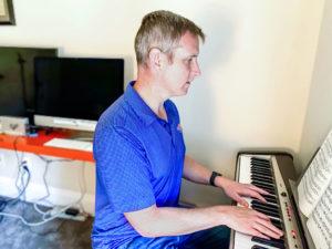 Michael Austin playing piano.