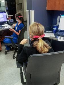 Nurses wear the ear guards Barras manufactured.