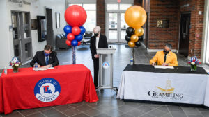 Under the watchful eye of Tech Provost Dr. Terry McConathy, Dr. Les Guice and GSU President Rick Gallot sign an MOU.
