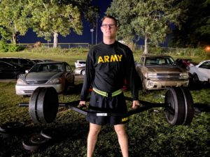 Army ROTC cadet works out for PT.
