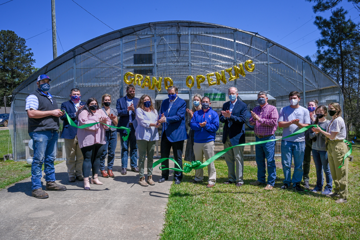 The ribbon is cut to open the renovated Louisiana Tech greenhouse.