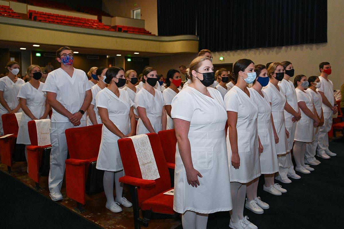 Student nurses await the pinning ceremony.