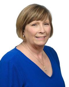Karen Colvin's headshot on a white background