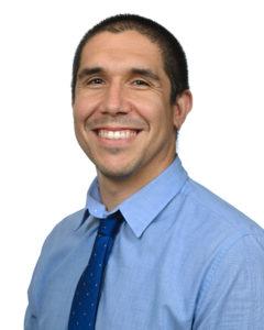 Michael Garza's headshot on a white background